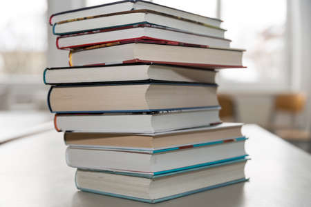 large stack of books with hard-bound books - hardcover
