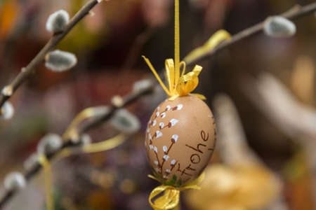 hand-painted Easter egg in Easter shrub with palm kitten - Easter decoration
