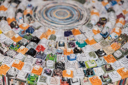 Creative design of an upcycling artwork made of colorful coffee capsules Standard-Bild