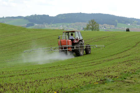 Use of pesticides in agriculture on a field in spring Stock Photo