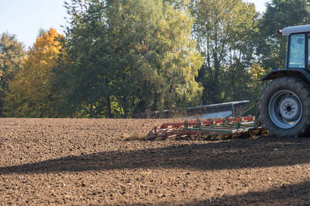 Farmer works with tractor and harrow on the soil - detail Archivio Fotografico - 106554800