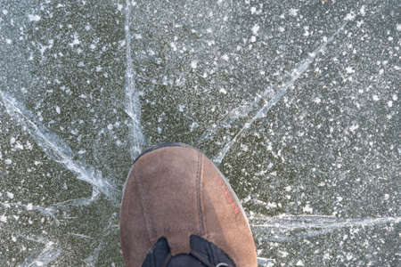 Person on thin ice sheet, this breaks - close-up