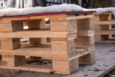 Upcycling with pallets of wood to a sofa and garden furniture Stock Photo