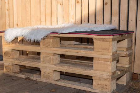 rustic bench made of sustainable raw material wood - upcycling europallets