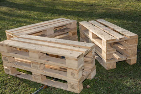 rustic and alternative seat set made of renewable raw material wood - upcycling wooden pallets Reklamní fotografie