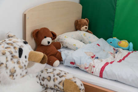 Nursery for toddlers with cozy blanket and plush toys - detail