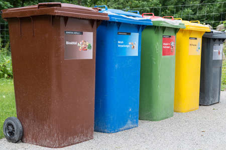 according to waste sorting system, different colored dustbins - Recycling Waste prevention 版權商用圖片