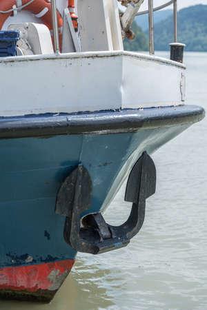 Anchor and lifebuoy at the bow of a ship - closeup