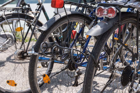 Theft-proof locked bicycles - close-up barrier with bicycle cable lock