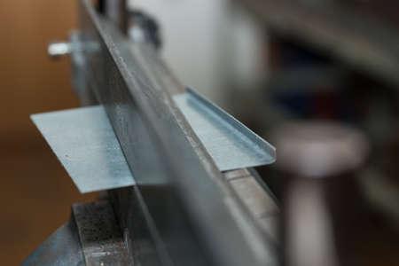 At bending machine galvanized sheet metal is folded - close-up metalworking Stok Fotoğraf