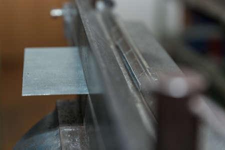 Bending sheet metal with bending machine - closeup metalworking Stok Fotoğraf