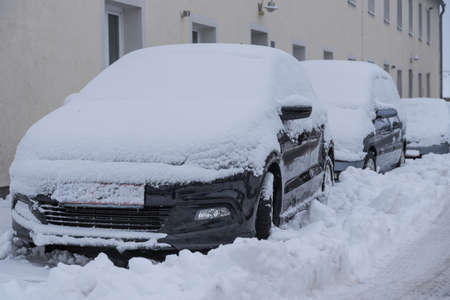 Road slippery due to winter and snowfall - snowed car