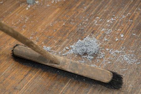 Workshop to clean metal shavings with wooden broom - close up broom Reklamní fotografie