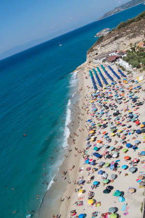 Beach filled with holiday guests for a beach holiday in Italy on the blue sea