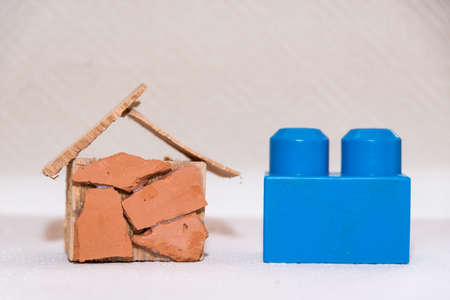 Model of a dream house shows with a child's play block size comparison - croped image