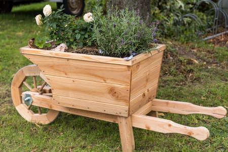 new wooden wheelbarrow also serves as a flower pot and decorative planter