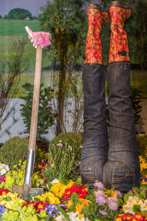 creative and fun garden decoration with garden tools, work clothes and flowers Stock Photo