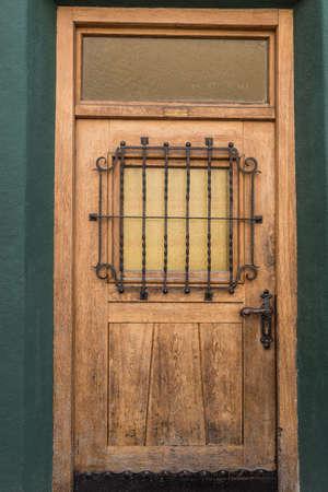 Weathered old solid wood door - front door closed