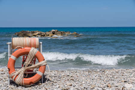 Lifebuoy on the pebble beach by the sea in Calabria - Italy