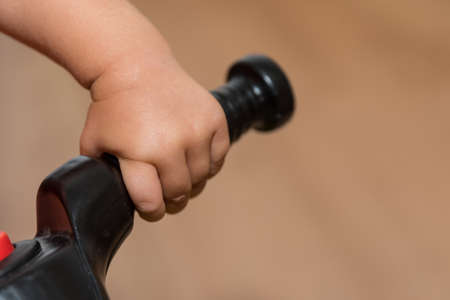 Hand of a child grabs toys - close-up child hand Stok Fotoğraf