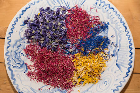 colorful tea herbs and medicinal herbs dried on plate - bird's eye view Standard-Bild
