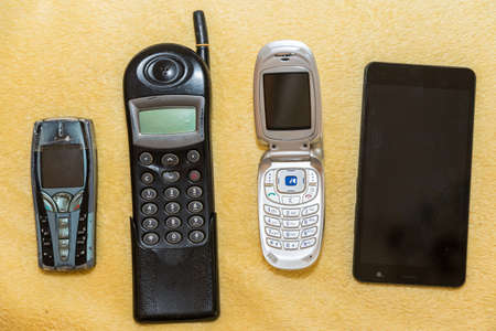 various cell phones - development in mobile technology and communication, optional