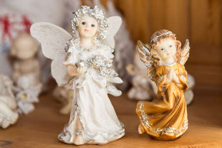 hand-painted white and gold angel as decoration