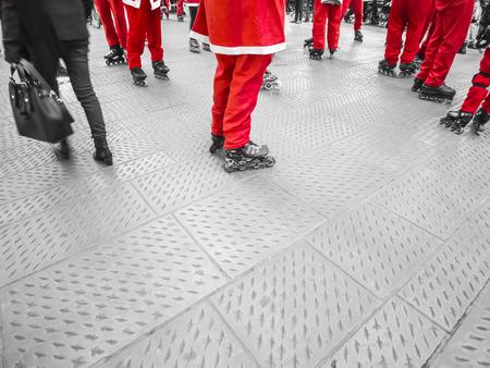 skaters: skaters dressed as Santa Claus space below