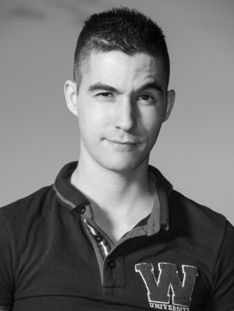 eyebrow raised: black and white man with raised eyebrow looking at camera