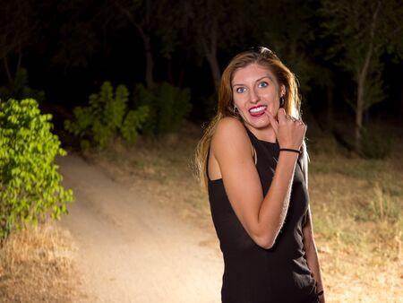 medium shot: blond woman sticking out her tongue