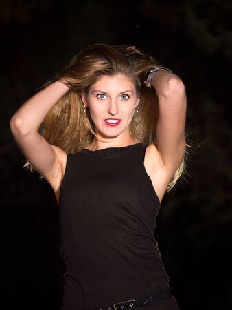 medium body: sexy blond woman clutching hair