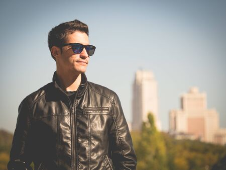 chaqueta de cuero: modern handsome young man in a leather jacket in madrid