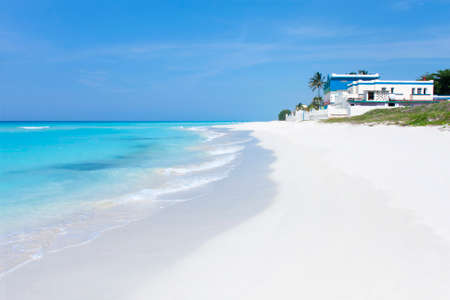 View from the shore of a paradisiacal beach in Varadero with crystal clear waters, white sand and blue sky. Cuba. Travel and tourism concept 写真素材
