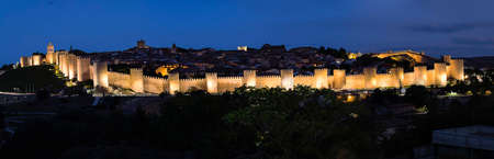 Night view of walls of Medieval city of Avila, Spain Stock Photo