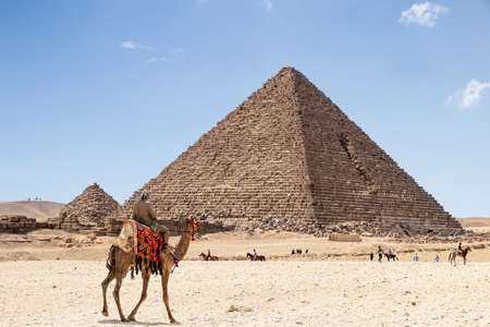 The Pyramid of Menkaure is the smallest of the three main Pyramids of Giza, located on the Giza Plateau in the southwestern outskirts of Cairo, Egypt. Stock Photo