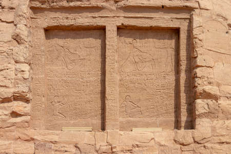 Hieroglyphs in the rock of Abu Simbel, Aswan, Egypt