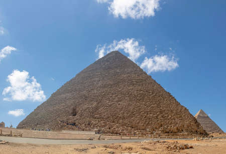 he Great Pyramid of Giza (also known as the Pyramid of Khufu or the Pyramid of Cheops) is the oldest and largest of the three pyramids in the Giza pyramid complex. Stock Photo
