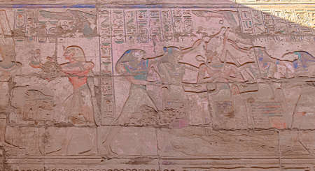 Polychromatic Hieroglyphs in Ruins of the Karnak Temple Complext at Luxor Stock Photo