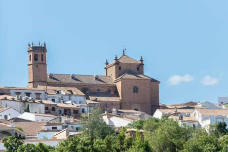 Facade and bell tower of church San Mateo, gothic and renaissance church, in old town of Banos de la Encina, Jaen, Andalusia, Spain