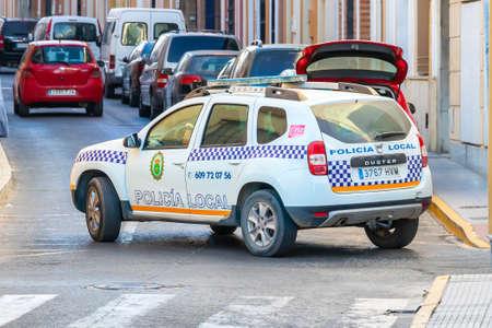Bonares, Huelva, Spain - August 14, 2020: Municipal police car, brand Dacia Duster, patrolling by the streets Editorial
