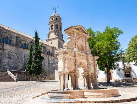 View of the Santa Maria fountain with Baeza Cathedral in Jaen, Spain, from Plaza de Santa Maria (Saint Mary square)