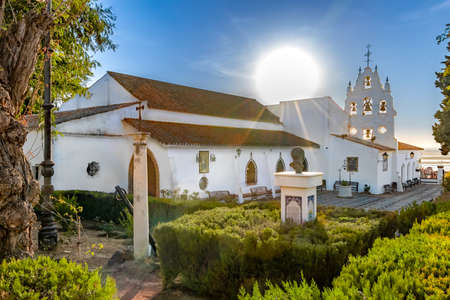 Huelva, Spain - September 8, 2020: View of Sanctuary Virgen de la Cinta from Gardens, backlighted with sun flares, patron virgin of huelva since 1586. church on El Conquero hill in Huelva, Andalusia