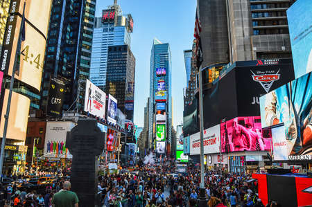 New York City, USA - June 7, 2017: View of anonimous people in Times Square at sunset