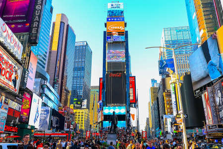 New York City, USA - June 7, 2017: Advertisements in Times Square at sunset Editorial