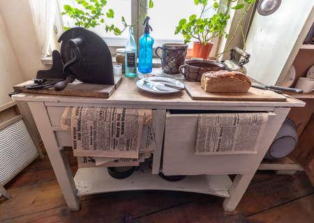 Krakow, Poland - June 3, 2018: Typical kitchen table used in german-occupied Poland. Inside Oskar Schindler's Enamel factory museum