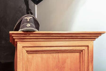 Krakow, Poland - June 3, 2018: Schutzstaffel (SS) skull hat sits on display in Oskar Schindler's Enamel factory museum