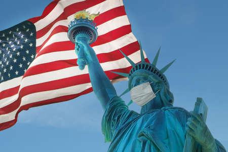 Statue of Liberty with a protective medical mask. COVID-19 coronavirus quarantine Banco de Imagens - 157517029