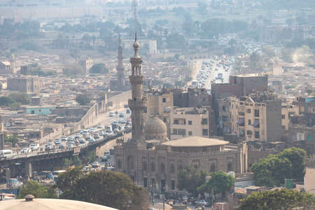 Cairo, Egypt - September 15, 2018: View of misty of city of Cairo in Egypt, due to traffic pollution, over rooftop slums and mosques