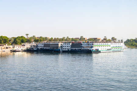 Aswan, Egypt - September 16, 2018: A lot of Floating hotels (tourist boats) moored between Luxor and Aswan in central Egypt for lack of tourism
