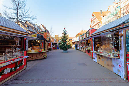 Colmar, France - december 1,2019: Christmas Market between traditional half-timbered houses in the city of Colmar, Alsace region, France Sajtókép